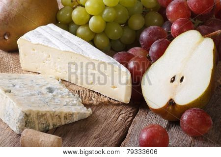 Cheese With Grapes And Pears Close-up Horizontal