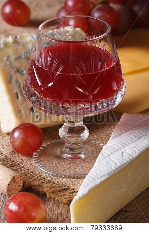 Red Wine With Cheese And Grapes Close-up Vertical