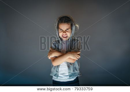 baby girl angry on a gray background art