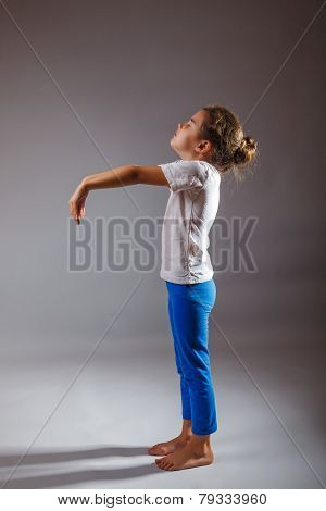 lunatic girl asleep standing on gray background