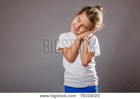 lunatic girl sleeps standing hand under his cheek on a gray back