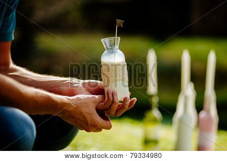 Milk In Glass Bottle In Father's Hands