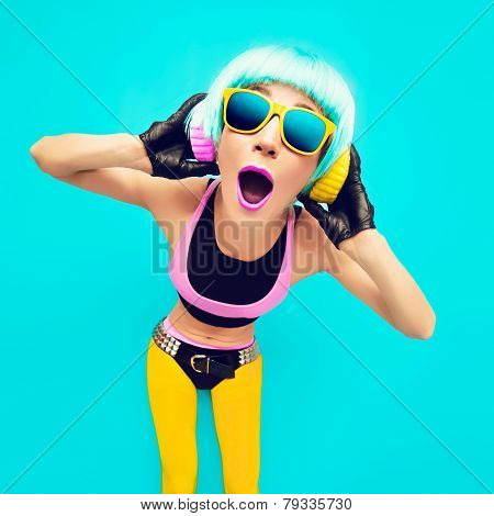 Glamorous Party Dj Girl In Bright Clothes On A Blue Background Listening To Music.