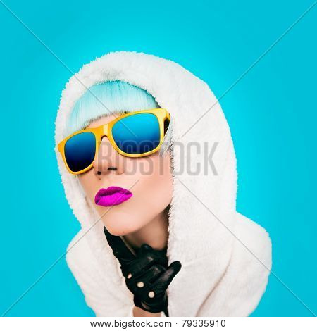 Fashion Girl In A White Hoodie On A Blue Background. Winter Style