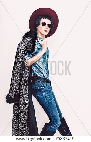 Glamorous Fashion Model In Coat And Stylish Jeans Clothes. Fashionable Autumn Look