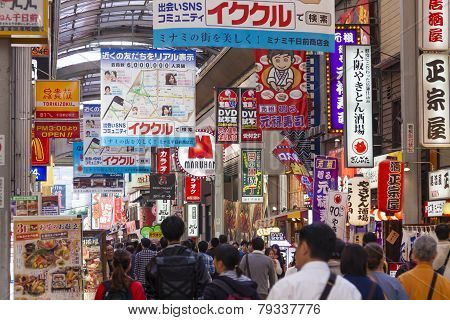 People Visiting A Shopping Street In Osaka, Japan.