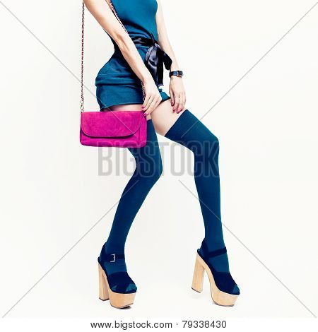 Sexy Glamorous Lady In The Green Dress And Stockings On White Background. Pink Clutch. Fashion Acces