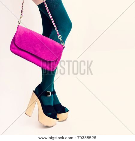 Sexy Glamorous Lady In Green Stockings On White Background. Pink Clutch. Fashion Accessories.