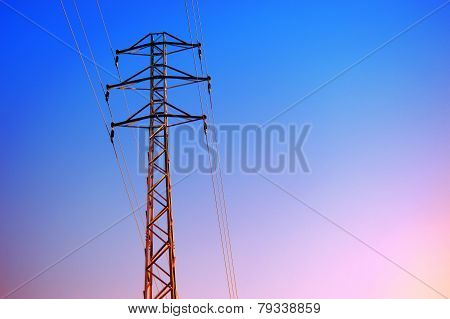 high voltage tower against the afternoon sky.