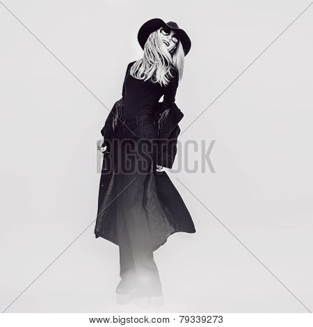 Happy Glamorous Lady In A Black Coat And Hat. Black And White Vintage Style