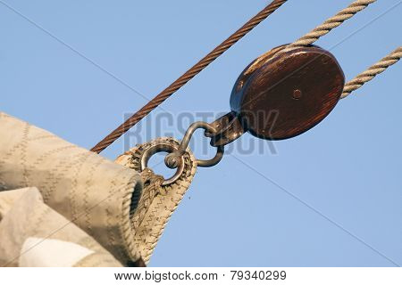 wooden pulley on a sailboat
