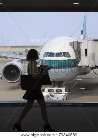 Businesswoman Boadring An Airplane