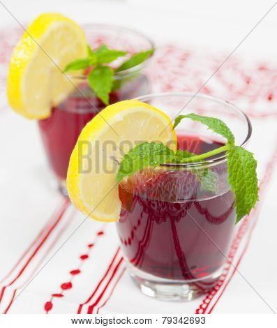 Two Glasses Of Red Fruit Juice With Lemon