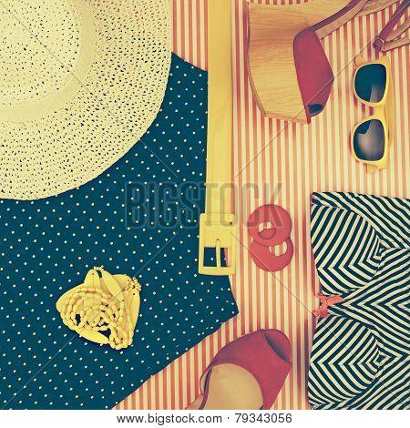 Still Life Of Retro Beach Themed Womens Clothing