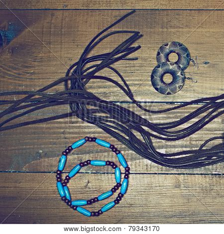 Assortment Of Jewelry On Wooden Background
