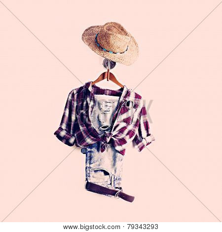 Plaid Shirt And Jeans On Hanger With Sunhat