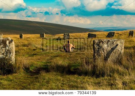 Pagan man at the Grey Wethers Stone Circles, Dartmoor