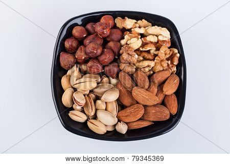 Assorted nuts in ceramic bowl