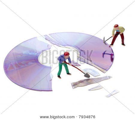 Miniature Toy Workers Repairing Computer Broken Compact Disk