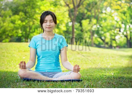 Young Woman Doing Yoga Exercises Outdoor
