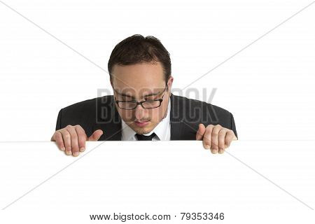 Young Businessman Behind White Wall