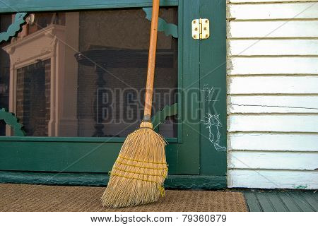 old broom with hobo sign