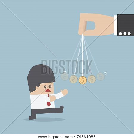 Businessman Being Hypnotized With A Dollar Coin