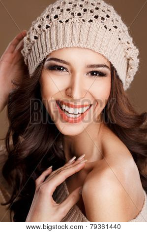 Portrait of a beautiful brunette in winter hat.