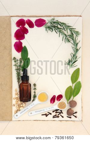 Pagan love potion ingredients over natural hemp notebook and mottled cream paper background.