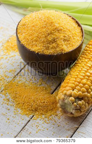 Corn Cob Amd Corn Meal On Wooden Background