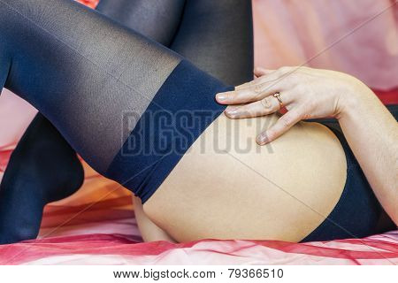 Women straighten up black stockings