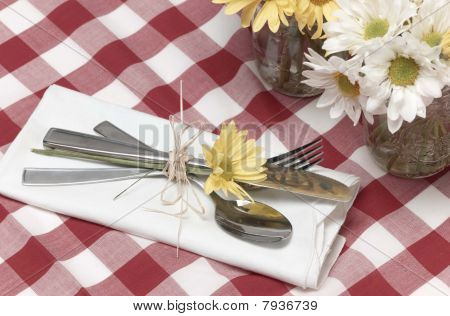 picnic silverware and flowers