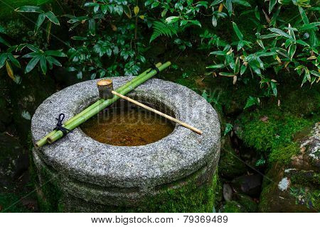 Water dipper on a stone basin at Koto-in Temple in Kyoto Japan