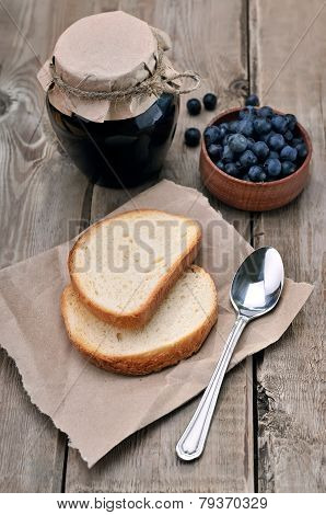 Bread And Blueberry Jam In Glass Jar