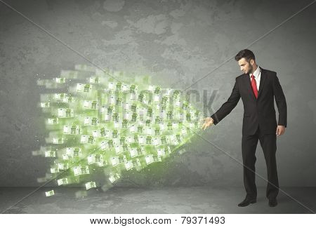 Young business person throwing money concept on background