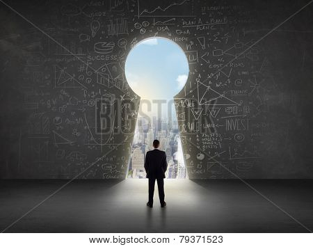Business man looking at keyhole with bright cityscape concept background