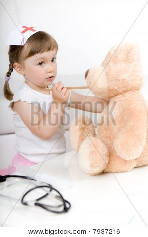 Little Girl Doctor With Teddy Bear