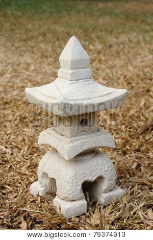 Sculptuer Of House With A Chinese Style Roof On Dry Turf 2