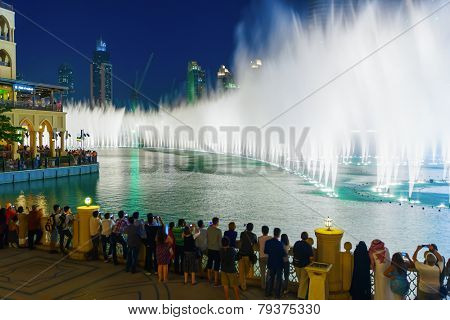 DUBAI - OCT 15: The Dubai Fountain on October 15, 2014 in Dubai, UAE. The Dubai Fountain is the world's largest choreographed fountain system set on the 30-acre manmade Burj Khalifa Lake