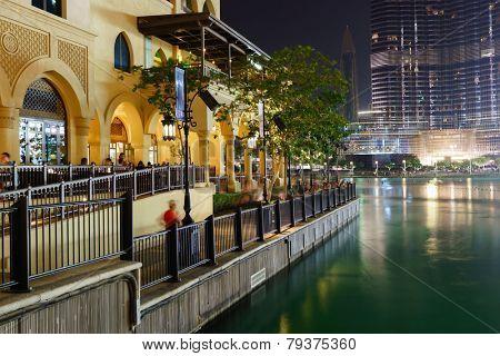 DUBAI - OCT 15: area near the Dubai Fountain on October 15, 2014 in Dubai, UAE. The Dubai Fountain is the world's largest choreographed fountain system set on the 30-acre manmade Burj Khalifa Lake