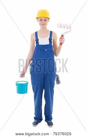 Young Woman Painter In Blue Coveralls With Builder's Tools Isolated On White