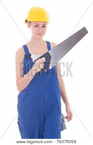 Young Beautiful Woman Builder In Blue Coveralls With Manual Saw Isolated On White