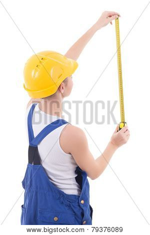 Back View Of Woman Builder In Blue Coveralls Measuring Something With Measure Tape Isolated On White
