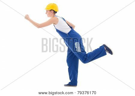 Career Concept - Happy Woman Builder In Blue Coveralls Running Isolated On White
