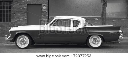 Classic Automobile In A Parking Area. Black And White