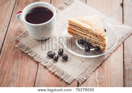 coffee, cake and peanuts on the wood background