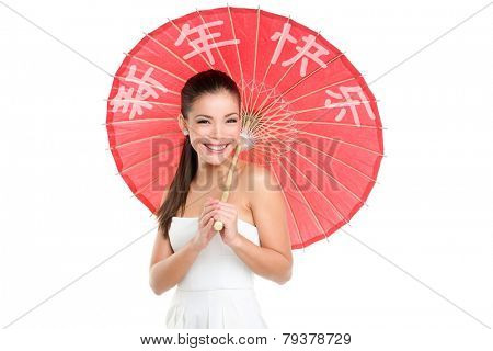 Chinese new year woman with traditional umbrella with HAPPY CHINESE NEW YEAR written in Chinese. Beautiful mixed race Chinese Asian / Caucasian girl isolated on white background smiling pretty.