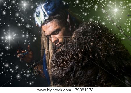 Close-up Portrait Of A Male Werewolf In The Skin On A Dark Background With Stars.