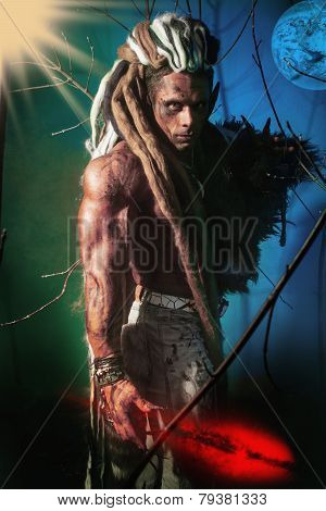 Muscular Man With Dreadlocks Werewolf On A Colorful Background With Moon And Stars