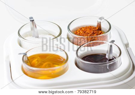 Thai Seasoning Container Include Cayenne Pepper, Sugar, Fish Sauce And Chilies In Vinegar.